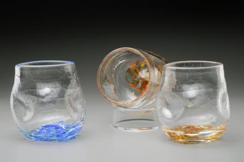 """Crackle Thumblers are hand-sculpted and freeblown, no mold. Crackle appearance/texture and thumb/finger depressions for a """"no slip grip""""!  These fun to hold, and drink from glasses are approximately 3 X 3 inches. Currently offered in """"Summer Seas"""" (blues, little white and green), shown on left, and Fall Foliage (amber/orange/red blend), center and right. Please specify color preference in Order Notes and/or contact me with any questions."""