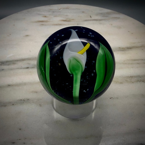 Calla Lily glass paperweight, over Starry Nights background, torchwork handblown glass, made in Vermont by Glass Artisan Chris Sherwin
