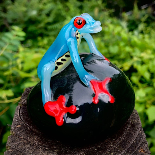 """Costa Rica frog paperweight, Teal blue frog on black base, 3"""" hand sculpted glass frog with orange murrine eyes, and bright orange feet gripping the base. Made here at Sherwin Art Glass studio overlooking the Connecticut River in Bellows Falls, Vermont."""