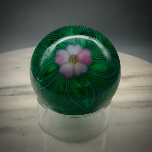 """Art Glass Paperweight, with Cobalt feather pattern, over green, with California-style torchwork blush pink 5 petal center flower, murrine center cane, 3"""" paperweight."""