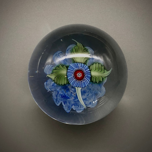 """small Nosegay paperweight, glass paperweight, small collectible paperweight, with millefiori and all glass torchwork leaves over blue optic background,  by Chris Sherwin, glassblower in Bellows Falls, Vermont, one of a kind, approx 2"""""""