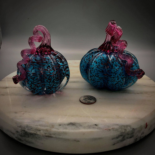 "gorgeous and colorful hand-sculpted Teal over Ruby solid glass pumpkins, with Gold Ruby optic stem, handmade by glassblower Chris Sherwin in his Bellows Falls , Vermont studio. available in two sizes: Small (3"" +-) and Medium 4"" (+-)"