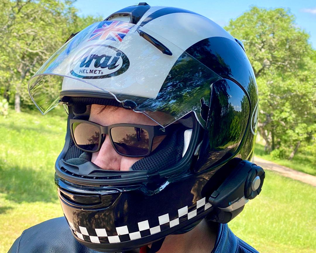 Close-up of serious motorcyclist wearing Kingfisher sunglasses inside of their helmet