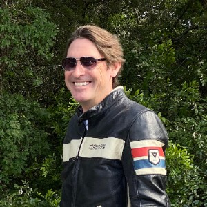 Motorcyclist wearing Kestrel Aviators smiles at the camera