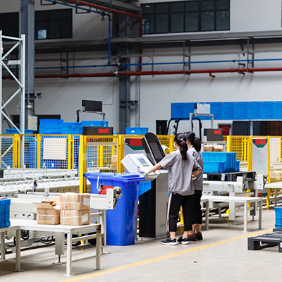 two employees working in factory