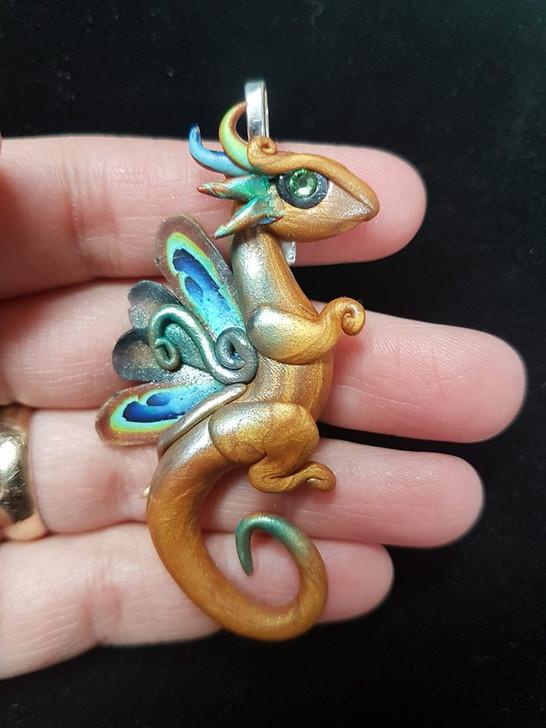 Golden baby dragon pendant