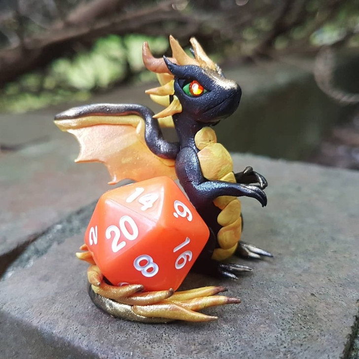 Small D&D Dragon with Dice Yellow Orange