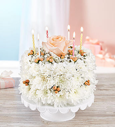 Birthday Wishes Flower Cake™ Sweetness DESIGN COUNCIL EXCLUSIVE Start with a truly original idea, throw in dash of flowery fun and you've got one sweet birthday celebration! Our new flower cake is a fresh delight, hand-arranged with soft white blooms and a delicate rose on top.