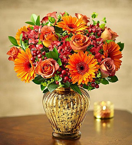 In Love With Fall Bouquet™ EXCLUSIVE For anyone in love with fall's vibrant beauty, we've got just the gift. Our best-selling arrangement showcases a luxurious gathering of blooms in rich autumn tones. Hand-designed inside our distressed mercury glass vase with a lustrous metallic finish, this statement-making bouquet will be at the center of every celebration.