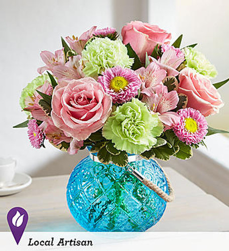Splendid & Sweet™ DESIGN COUNCIL EXCLUSIVE Country charm meets global chic. A mix of fresh blooms in soft shades of pink & green, offset by the splash of blue color from our exclusive new globe vase. Inspired by the blue water of the Mediterranean Sea, this striking, globe-shaped glass bowl features an antique pressed design and rustic rope handle. The added tea light candle turns it into a gorgeous candle holder after the flowers are gone.