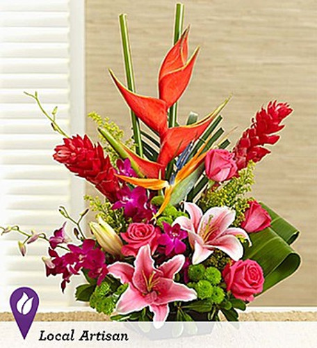 When floral designer Yunus arrived at his hotel during a recent trip to Hawaii, he was greeted by beautiful floral arrangements featuring Stargazer lilies and ginger. He was also thrilled to see Stargazers—his favorite flower—showcased in the hair of the local hula dancers. To bring this unforgettable experience home, he's created a truly original arrangement of Stargazer lilies, Dendrobium orchids, ginger, heliconia, and more, gathered fresh to deliver a little piece of paradise to their day.