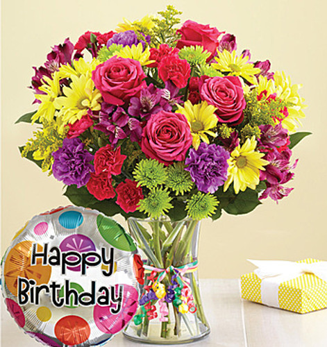 "Get the birthday party started with a bunch of smiles! Our bright & colorful bouquet of fresh carnations, daisy poms and more—complete with a festive ""Happy Birthday"" balloon."