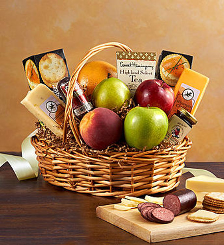 Fruit & Gourmet Basket Express your best wishes with a gourmet greeting they won't soon forget. Created by our select florists, this gourmet basket is crafted with fresh apples and oranges, grapefruit, pears, sausage, cheese, crackers, cookies, and more.