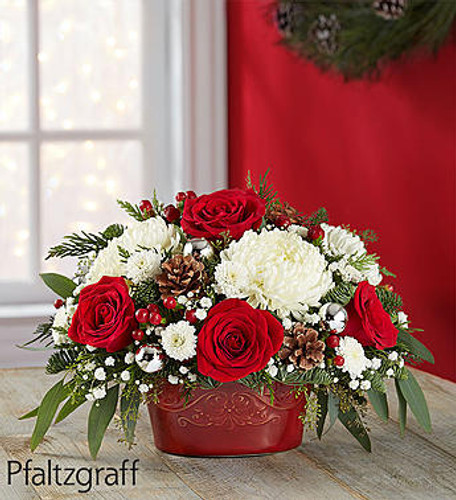 EXCLUSIVE We've cooked up a wonderful, all-in-one gift for all their holiday gatherings. Created exclusively through our collaboration with Pfaltzgraff, this unique gift combines a joyful seasonal arrangement with a versatile entertaining piece. They'll love displaying the festive Christmas blooms, then using the petite, crimson-colored casserole over and over, which lets them simply cook, serve, save and enjoy! It's an everything-safe 16-ounce bakeware essential that can be used for small hors d'oeuvres or large condiments.