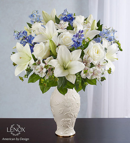 EXCLUSIVE Offer heartfelt comfort and support with our Loving Blooms™ bouquet. Heavenly blue and white flowers are artistically arranged inside our exclusive Lenox® porcelain vase. The touching keepsake features an exquisite raised floral design and a 24 karat gold trim at the base for a beautiful expression of your sympathy.