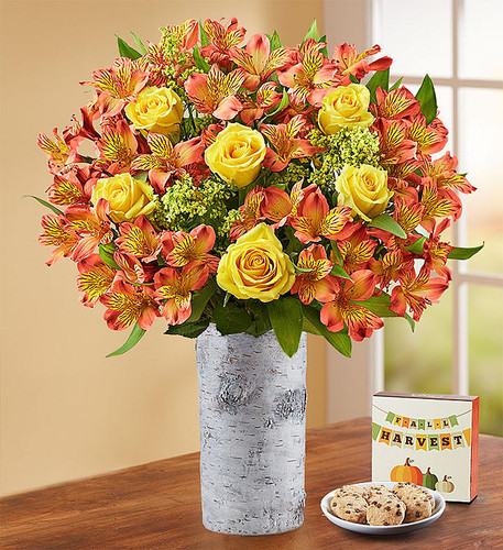 Our fresh fall bouquet is brimming with beauty and color. Vibrant long-stem yellow roses pair with rich orange Peruvian lilies to make every birthday, anniversary, housewarming or homecoming a little brighter.