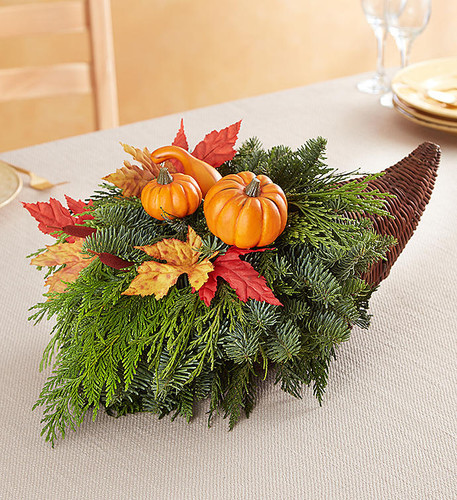 The timeless beauty of our Thanksgiving centerpiece brings a new tradition to the holiday celebration. Our wicker cornucopia basket—a symbol of abundance—is gathered with lush, long-lasting evergreens and rich autumn accents. Filled with rustic beauty, this festive gift is perfect for sharing memorable occasions with friends and family.