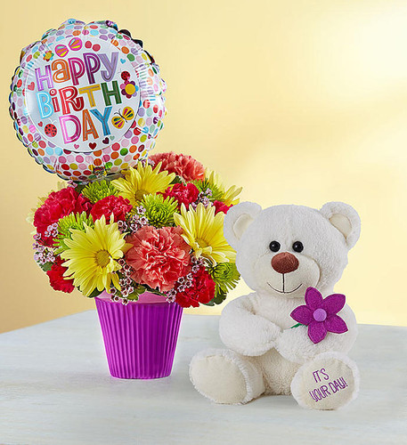 "EXCLUSIVE Our amazing gift includes 3 fabulous gifts in one! It's a value that will make them feel extra special, because when it's their birthday, you want to send love …and lots of it! We've bundled a bright bouquet and balloon delivered by an adorable plush bear with a message on his paw: ""It's Your Day!"" This all-inclusive party package is sure to make them beam on their big day."