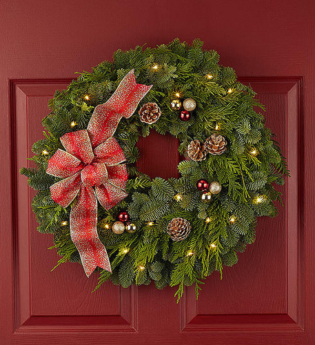 EXCLUSIVE Few things evoke the joy of Christmas like the scent of fresh evergreen. For example, our fragrant balsam wreath with a bright red bow. Keep it festive and simple... or upgrade your gift to include clusters of red and gold glitter ornaments, gold tipped pine cones & and a shimmering red ribbon. To really get everyone into the holiday spirit, add a string of bright LED lights!