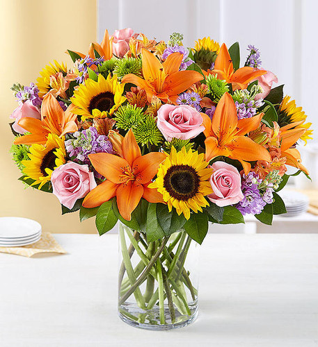 Designed to be as unforgettable as the person who receives it, our luxurious arrangement of colorful, fresh-from-the-garden blooms, artistically designed inside a chic cylinder vase by our expert florists, creates the ultimate wow gift for someone who means the world to you.
