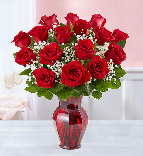 Flowers speak louder than words…and our red roses speak volumes! Beautifully hand-arranged with greenery inside our ruby red vase, each bloom will help you express your love in the most romantic way possible.