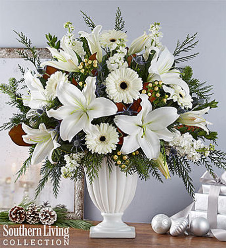 EXCLUSIVE Nothing wow's like winter white blooms. Created exclusively through our partnership with Southern Living, our wonderful winter arrangement showcases an abundance of snow-white blooms magnificently offset by a variety of lush greens. It's all gathered into our Graceful Pedestal Vase featuring delicate fluting and graceful curves for a statement-making gift they won't soon forget.