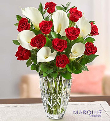 A dozen classic long-stem red roses and six pristine white Calla lilies are gathered to create one unforgettable bouquet. And paired with our classic Marquis by Waterford crystal vase in the stunning Sparkle pattern – it's a gift that's simply extraordinary.