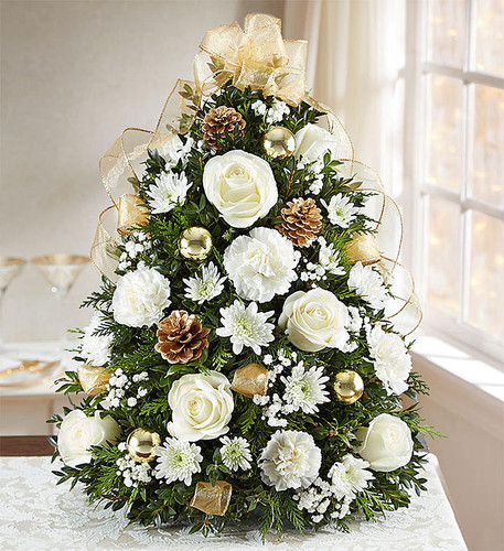 We've put a luxurious new spin on our customer favorite Holiday Flower Tree. Hand-designed in ivory & gold, this stunning tabletop display is trimmed with glistening gold ribbon. It's a truly unique gift that brings joy to their world and beauty to their holiday celebrations.