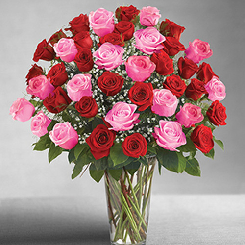 Your ultimate love deserves the ultimate gift -- four dozen of the freshest long-stem pink and red roses. There's no doubt who the love of your life is when you send this beautiful floral fantasy, hand-arranged by our florists in a striking glass vase.