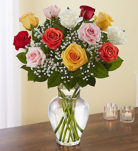 "Our rainbow of long stem roses is an elegant surprise for someone who brings color to your world. Beautifully arranged by our expert florists with lush greenery inside a classic glass vase, 12 or 18 vibrant blooms are hand-delivered and ready to delight the people you care about for big celebrations and every ""just because"" moment in between."