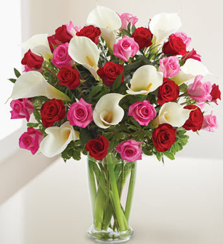 At last. A large and lovely bouquet that says it all (and then some). Passionate premium long stem red roses, romantic premium long stem hot pink roses, and stunningly beautiful white Calla lilies, hand-designed in a premium clear glass vase. Couldn't have said it better ourselves.