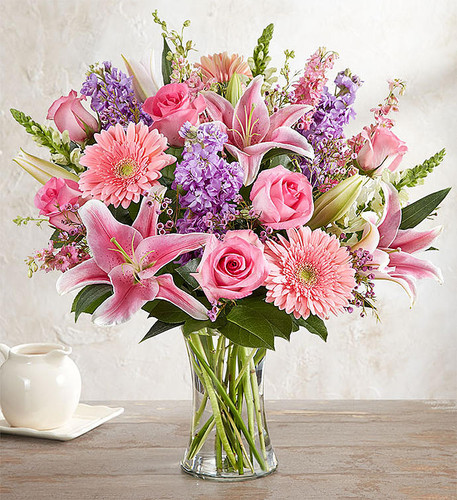 When it comes to letting her know she's always on your mind, think pink and lavender. We've hand-gathered a romantic mix of pink and purple blooms to create a gorgeous, garden-inspired bouquet. Designed by expert florist Breanna Cartwright of Modesto, CA, this beautiful bunch will remain a fond memory for a long time.