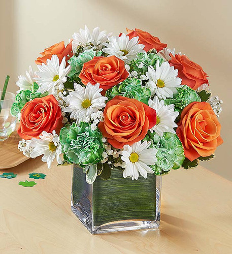 Irish eyes are sure to be smiling when our popular St. Paddy's Day bouquet is on display. This compact arrangement is hand-gathered with blooms in the traditional colors of the Irish flag, bringing an abundance of blessings to their hearts and homes.