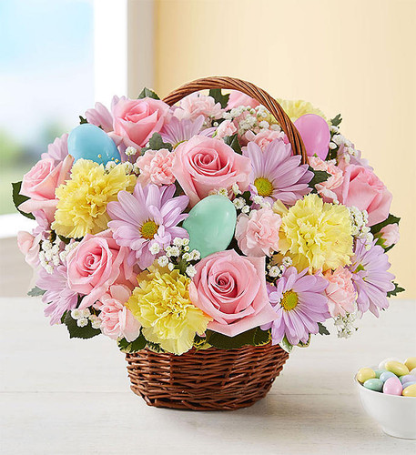 Send our delightful Easter Basket bouquet, and they'll carry your thoughtfulness with them through the holiday and beyond. We've gathered our freshest blooms in pastel shades of pink, yellow, and lavender inside a charming rustic basket with colorful Easter eggs for a truly festive surprise. Makes an especially lovely gift for the holiday host!