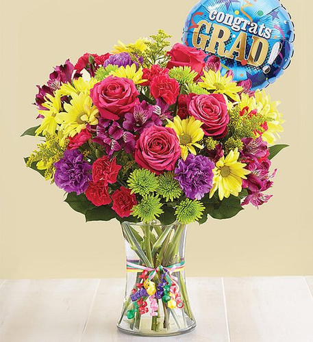 Every graduate deserves a day to celebrate, and we've got just the gift. Our hand-designed bouquet is brimming with the best and brightest blooms, gathered inside a charming vase, tied with ribbon. We've even included a festive balloon for an extra special way to remember their milestone!