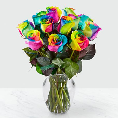 Picked fresh from the farm to bring your special recipient a bouquet like none other, the Time to Celebrate Rainbow Rose Bouquet is a unique gift they will always remember. Hand gathered in select floral farms, these kaleidoscope inspired roses have been dyed so that each petal displays a different vibrant hue of either yellow, blue, green, purple or pink to create a flower arrangement picked fresh for you to get the party started.