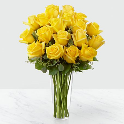 Sunny yellow roses are a cheery and wonderful gift. Celebrate a birthday, anniversary, graduation or any occasion with this lively bouquet of roses with seeded eucalyptus in a clear glass vase.