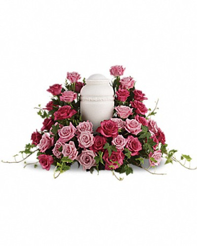 An awesome display of pink roses are lovingly arranged with ivy and other gentle greens to display the urn.Please note: Arrangement does not include urn.