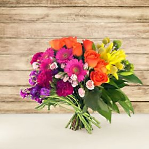 "Express appreciation to everyone in your life by sending the You Color My World Bouquet. Designed in collaboration with Carrie Colbert, whose lifestyle brand slogan is ""More Color, Please!"", the You Color My World Bouquet is sure to brighten any recipients day with its bold rainbow hues. Believing in the power of color to spark joy, Carrie created this bouquet specifically for times such as this. Who among us couldn't use a special dose of rainbow and sunshine floral goodness? You'll certainly make a statement when you send this eye-catching bouquet. What are you waiting for? Don't be a shrinking violet- live out loud when you send this modern marvel!"