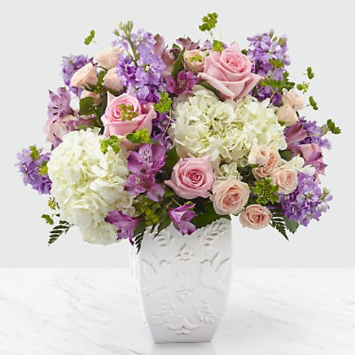 We know that saying farewell to a loved one is often a celebration of life. Our Peace and Hope™ Bouquet sends thoughtfully shares your love with its combination of a lavender color palette and an elegant array of roses, stock, hydrangea and alstroemeria