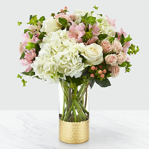 Our Simply Gorgeous™ Bouquet is a gift they will simply never forget. This fresh bouquet is filled with blushing, beautiful texture and soft pastel hues to complement any message of love. It's handcrafted with spray roses, roses and hydrangea in a glass vase for your special people.