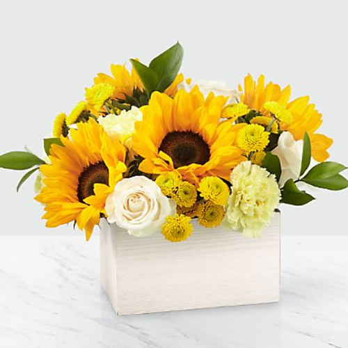 This sunny bouquet is perfect for the sweetest person you know! Inspired by the warm weather favorite, our Sweet as Lemonade™ Bouquet is crafted with sunflowers, roses and carnations by a local florist and delivered right to them.