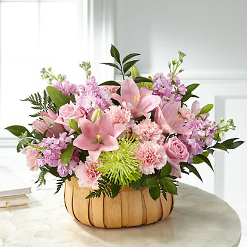 Let them know how much you care with a gorgeous bouquet that features carnations, stock, roses, lilies and Fuji mums. Each bloom is a thoughtful reminder of your support and love, while sitting in a beautifully crafted basket.
