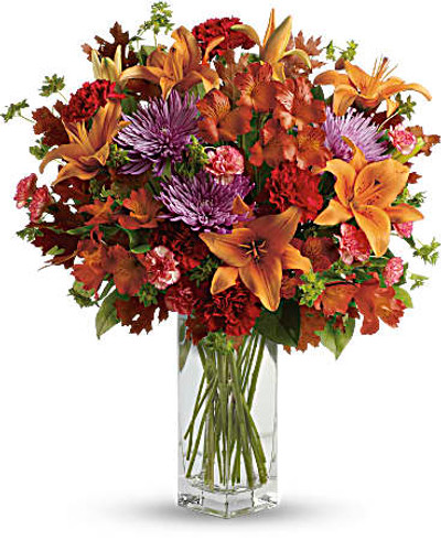 Ring in the season with this fresh, colorful arrangement of lilies and alstroemeria. Hand-delivered in our beautifully crafted vase, it's an easy way to brighten anyone's day!