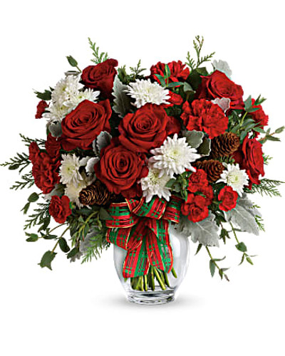 This bold bouquet includes red carnations, red miniature carnations, white cushion spray chrysanthemums, flat cedar, noble fir, dusty miller, parvifolia eucalyptus, small pinecones and wired ribbon.