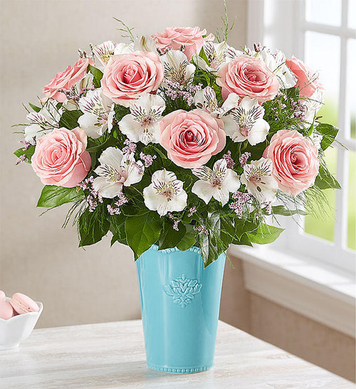 EXCLUSIVE Our Sweet Blooms Flower Arrangement is sure to delight with its uniquely elegant design. Delicate pink & white flowers are artistically arranged inside our keepsake glazed aquamarine vase for vibrant style. Inspired by handcrafted antiques, this striking vase flaunts an acanthus-leaf motif and scalloped edge trim with beaded detail, creating a special gift they'll enjoy for years to come.