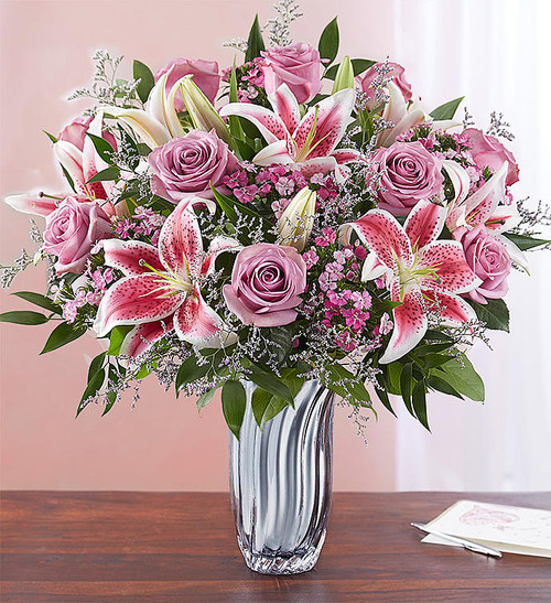 EXCLUSIVE Radiance meets romance for a true reflection of your love. Our hand gathering of blooms is designed to delight the one who has caught your eye.  With our Silver Radiance Vase flaunting soft, silvery cascades, this bouquet goes above and beyond to let your sentiments shine.