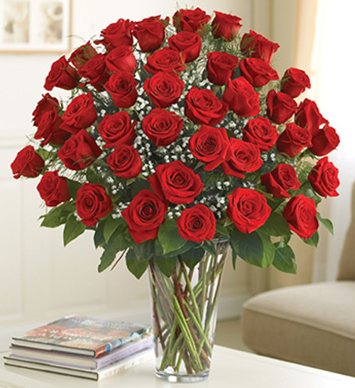 Your ultimate love deserves the ultimate gift -- four dozen of the freshest long-stem red roses. There's no doubt who the love of your life is when you send this beautiful floral fantasy, hand-arranged by our florists in a striking glass vase.