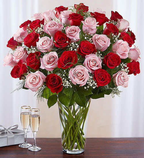 Our radiant long stem roses are the ultimate romantic surprise. Two, three or four dozen blooms in charming pink & classic red are artistically arranged by our expert florists inside an elegant glass vase and personally hand-delivered to help you express how you feel in a beautiful way.
