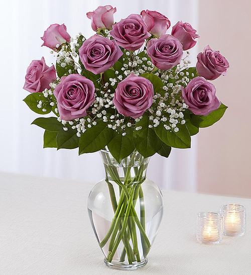 "Our lovely lavender roses are an elegant surprise for someone who means so much to you. Beautifully arranged by our expert florists with lush greenery inside a classic glass vase, 12 or 18 charming blooms are hand-delivered and ready to delight them for big celebrations and every ""just because"" moment in between."